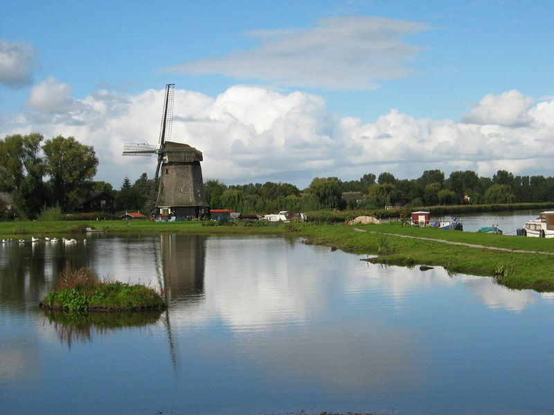 Windmill and lake in the Netherlands