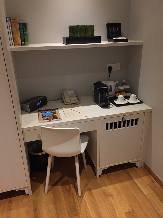 desk in room at hotel adonis, sinapore