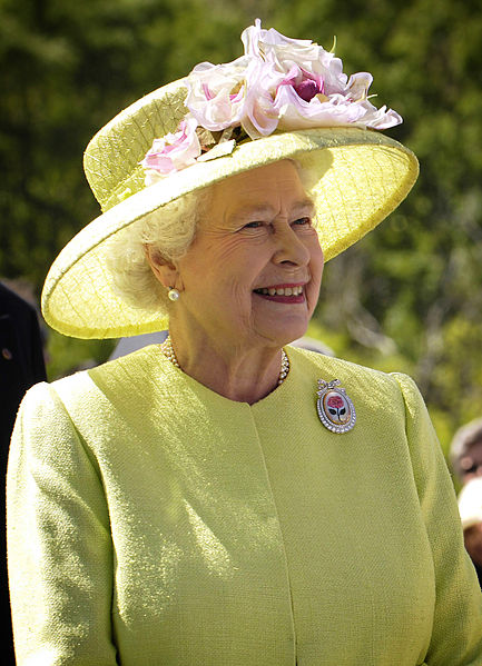 The Queen of England in a yellow dress