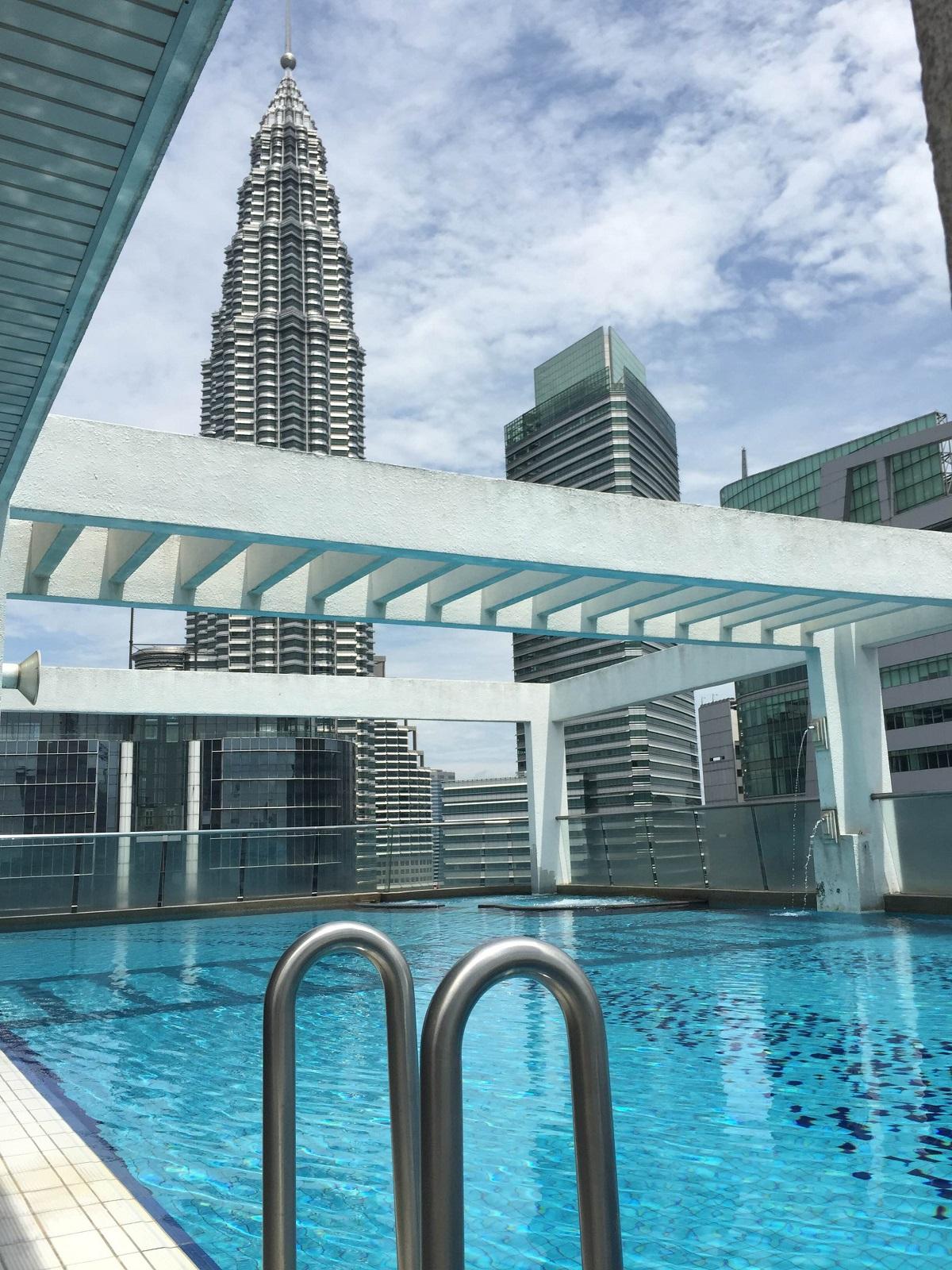 Petronas Towers from rooftop pool in Kuala Lumpur, Malaysia