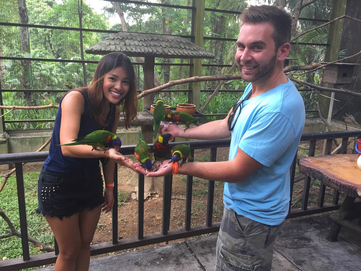 feeding the birds at the bird park in Kuala Lumpur