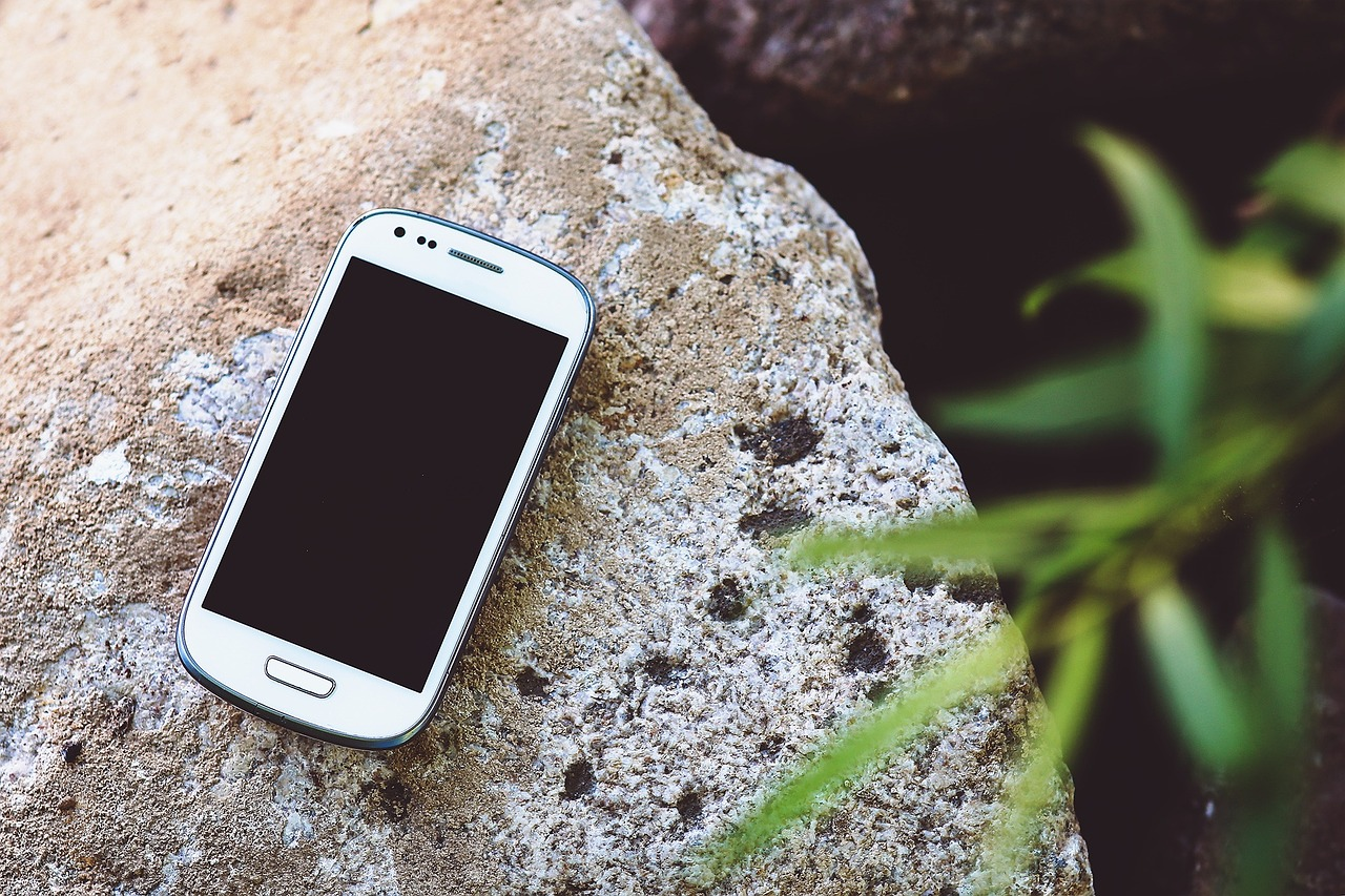Your smartphone goes camping in the outdoors better than you think it will ... photo by CC user Kaboompics_com on pixabay