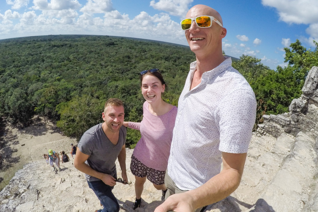 climbing coba in the yucatan on our motorcycle road trip in mexico